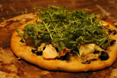 Mushroom, arugula, and goat cheese pizza