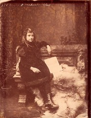 Irish Girl (19th Century?) (Mike Gerrish) Tags: ireland irish sepia pose photo republic boots victorian 123 eire photograph bow ribbon elegant foundphoto limerick georgest ringlets foundimage glassplatenegative irishgirl viennastudios 123oconnellstreet