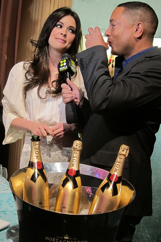 2011 Oscar Food: Katie Lee pours Moet Silver Screen Punch for a reporter.