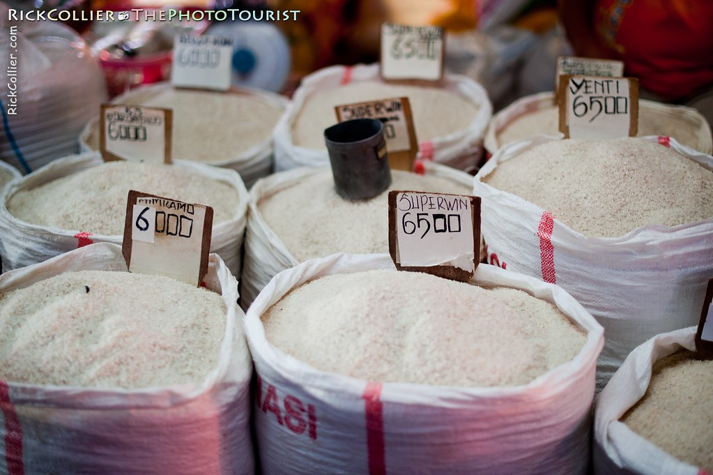 Bags of rice are priced for sale by the cup, in the market at Aertembaga Market, Bitung, North Sulawesi, Indonesia