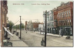 Lincoln Avenue looking east, Goshen, Indiana (Hoosier Recollections) Tags: horses people woman usa signs man color men history buildings walking advertising awning women restaurants indiana streetscene transportation shops pedestrians storefronts buggy buggies businesses goshen elkhartcounty hoosierrecollections