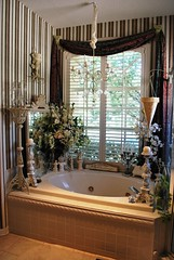 A romantic bubbly getaway... (Bellafaye) Tags: flowers window bathroom silk chandelier romantic bathtub elegant decor candelabras candlestands