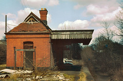 Tettenhall Station, Wolverhampton, April 1980 (Lady Wulfrun) Tags: abandoned overgrown station br platform railway disused canopy 1980 1980s gwr disusedrailway trackbed britishrailways tettenhall steantrains oxleyjunction april1980s tettenhallstation