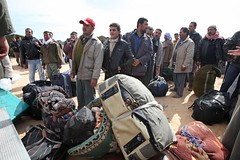 Emergency situation in Tunisia (UNHCR) Tags: africa camp man men home tunisia refugees border chinese egypt luggage relief staff help aid violence shelter emergency tension libya assistance unhcr turk austrian filipinos tunisian insecurity egyptians northernafrica humanitarianaid syrians moroccans libyans unrefugeeagency humanitariancrise rasdjir egyptianrefugees choucharasdjircamp