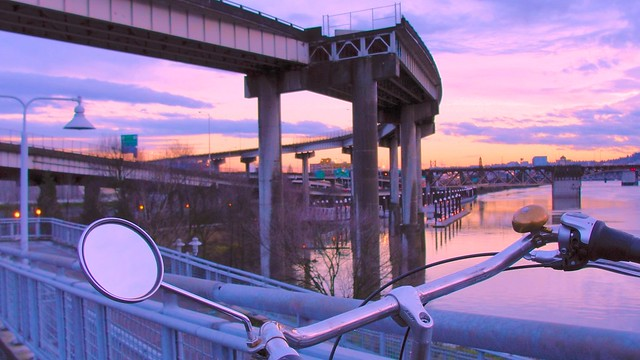 Bicycle handlebars looking out over the Willamette River and Interstate 5 in central Portland
