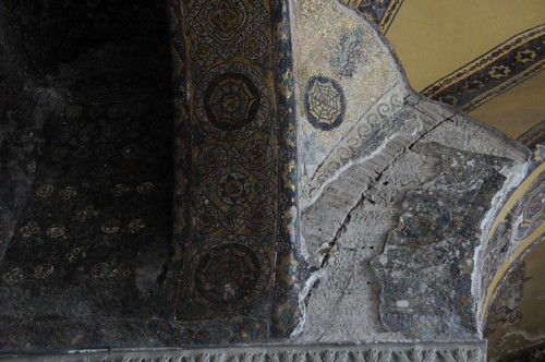 Corner showing intact mosaic next to plastered mosaic and painted Islamic decoration