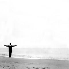 (Massimo Margagnoni) Tags: world boy sea portrait people blackandwhite bw italy white black art 6x6 film beach analog person solitude mare alone kodak tmax hasselblad beaches nero biancoenero mondo 500cm hasselblad500cm analogico hesselblad naturepoetry absoluteblackandwhite