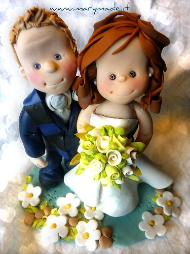Polymer clay cake topper for Laura and Marco