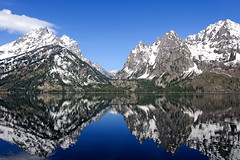 Cascade Canyon (bhophotos - not for much longer) Tags: travel blue usa white lake snow mountains reflection nature water landscape geotagged spring nikon wyoming nikkor tetons jacksonhole grandtetonnationalpark jennylake 2470mm cascadecanyon gtnp d700 2470mmf28g bruceoakley