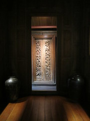 Teak wood as seen through a door at the Gold Pavilion at the Jim Thompson House in Bangkok, Thailand (Karin du Maire) Tags: door wood light house thailand shadows bangkok pavilion tha teak jimthompson jimthompsonhouse goldpavilion