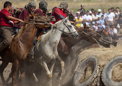 Horse Game For National Day, Bishkek, Kyrgyzstan (Eric Lafforgue) Tags: horses people horse playing male men animal sport horizontal headless danger speed fun mammal cheval person togetherness amusement fight asia exterior action capital crowd contest helmet fulllength culture competition arena entertainment riding together gallopinghorse tradition centralasia kyrgyzstan humanbeing saddle inaction horseriding gallop chevaux colorphoto contesting nationalday bridle horseman bishkek buzkashi 2774 capitalcity kyrgyzrepublic inmovement kirghizistan kirgistan kirghizstan equestriangames kirgisistan headprotector horsegames   kokboru ulaktartysh  goatcarcass quirguizisto oglaktartis