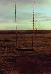 Suspended (dkilim) Tags: playground fuji minolta swing greece velvia macedonia thessaloniki 100 xd5  kalochori