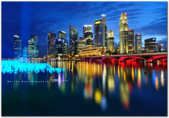 Singapore (fiftymm99) Tags: city bridge urban reflection marina river lights hotel bay singapore cityscape colours fireworks bank tourist celebration business laser colourful sands countdown merlion marinabay singaporeskyline 2011 merlionpark marinabaysands nikond300 fiftymm99 mygearandme gettyimagessingaporeq1