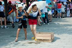 Near the Forbidden City, Beijing (k.dmitrijewa) Tags: street travel summer hat digital canon candid chinese beijing tourists parasol forbiddencity peking chine pekin pequim kna socialreportage  40d canon40d  pennyjey china2010