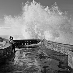 *EXPLORE* Love Makes Us Strong (Kvinn Photographie) Tags: square blackwhite couple child noiretblanc action wave splash vague enfant biarritz carr absoluteblackandwhite kvinnphotographie