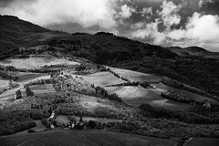 Patches of Light (Philipp Klinger Photography) Tags: italien light shadow sky blackandwhite bw italy cloud white mountain black mountains tree nature clouds forest landscape florence blackwhite nikon europa europe italia wine hill sienna hills tuscany chianti tele firenze cypress siena patch radda