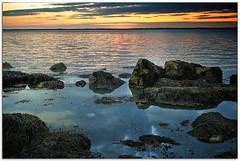Seaweed, Sunset and Rocks (Ian Johnston LRPS) Tags: sunset sea sky nikon rocks waves peace shore cowes 2010 gurnard 2470 d80
