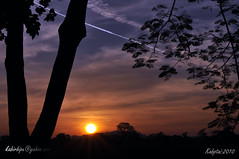 Last Sunset of 2010 with a jet contrail (K@BiR BiPU ( )) Tags: sunset sun beautiful wow nikon contrail jet kabir lastlight bipu d5000 nikond5000 sunset2010 kabirbipu