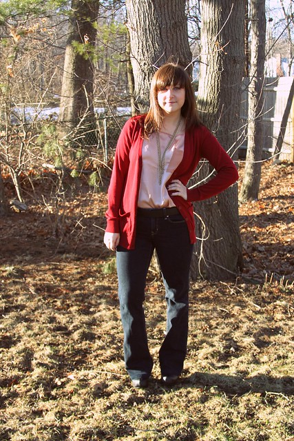 peach blouse, flare jeans, black wedges, maroon cardigan, gold necklaces
