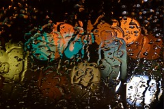 Through the Glass on a Rainy Night (Truebritgal) Tags: camera blue ohio orange white abstract black green window water glass rain night out grey lights evening nikon colorful neon dof bokeh stormy rainy raindrops colourful windshield straight windscreen steubenville unedited sooc wintersville d7000 truebritgal