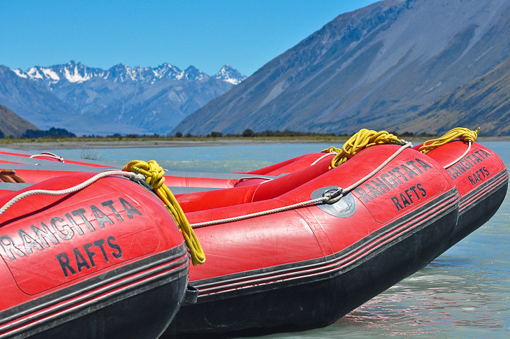 white water rafts on river bank