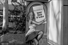Sex sells - 1 (manni39) Tags: street vintage blackwhite el vintagecamera nikkor markt schwarzweiss mainz nikkormat jahrmarkt spiegelreflex rolleiretro100 nikkormatel nikkorautos50mm14