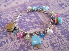 Sweet bracelet with aqua charms and bow - Braccialetto dolci azzurro (Il Cassetto di Momo) Tags: cute strawberry cookie sweet handmade polymerclay dolce biscuit cupcake marshmallow bow gelato kawaii bracelet lovely muffin lollipop dolci fiocco icelolly biscotto braccialetto leccalecca