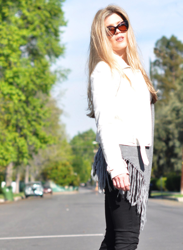 blonde hair and fringe cardigan sweater and white leather jacket and tom ford anouk cat eye sunglasses