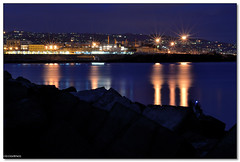 Catania - Starburst effect (ciccioetneo) Tags: italy seascape night speed port photography pier nikon long exposure italia slow shot harbour dusk east shutter sicily catania sicilia starburst rockscape twlilight d3100 ciccioetneo