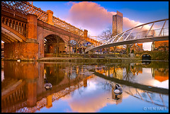 Manchester - Castlefield Viaduct and Merchant's Bridge over Bridgewater Canal (Yen Baet) Tags: old city uk greatbritain bridge sunset england reflection architecture modern reflections river manchester construction iron europe cityscape footbridge unitedkingdom britain hilton railway quay viaduct promenade british metrolink metropolitan lattice brickwork castlefield engeland redbricks bridgewatercanal  greatermanchester beethamtower cornbrook merchantsbridge catalansquare