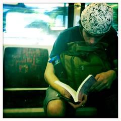 2.3 (dL-chang) Tags: guy colors reading hawaii publictransportation random thebus iphoneapp iphoneography hipstamatic
