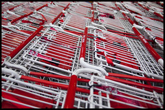 White and red repeated (Eric Flexyourhead (Trying to catch up!)) Tags: red white canada metal vancouver shopping wire downtown bc bokeh britishcolumbia trolley shoppingcart costco repetition carts olympusep1 panasoniclumix20mmf17