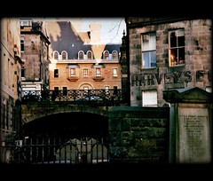 Close-knit Edinburgh (*l*a*u*r*a*) Tags: street city bridge houses windows urban house building film grave graveyard canon scotland scenery edinburgh view stones tomb cobble cobblestone walls canoneos pellicola urbanshot georgeivbridge urbanstreetview