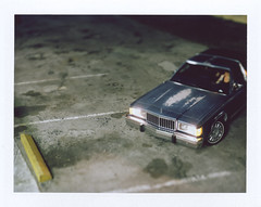 Car Polaroid (ari.gabel) Tags: longexposure film car night polaroid fuji shift headlights instant 4x5 tilt curb largeformat viewcamera sheetfilm autaut panpola