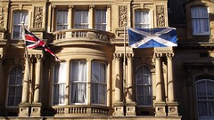 fluttering flags (byronv2) Tags: windows building architecture edinburgh flag flags unionflag oldtown saltire chambersstreet