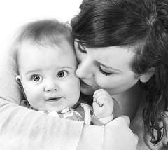 Jess and Lola B&W (Ellie Ellis) Tags: portrait blackandwhite woman baby love girl lady kiss affection daughter mother lola jess bond maternal