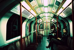 Jane Doe Underground (Cloni) Tags: city travel urban london train 35mm underground xpro fuji candid tube olympus crossprocessing xa3 xprocessing sensia dragondaggerawards