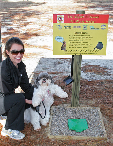 Elizabeth Brown and her dog Jane check out the pet waste disposal system at a park in Richland County, South Carolina.