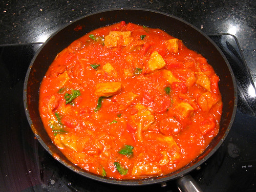 Pork with sweet paprika, peppers, tomato and basil