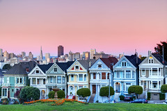 The Painted Ladies at Dusk (Jim Boud) Tags: sanfrancisco california travel houses light sunset skyline architecture buildings square lens landscape is skyscrapers dusk townhouse fullhouse usm alamo pinksky paintedladies alamosquare artisticphotography townhomes sanfranciscoskyline 1585 thepaintedladies jimboud canoneos60d jamesboud canonefs1585mmf3556