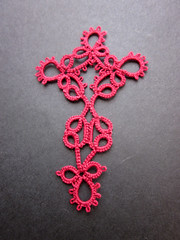 tatted red konior cross