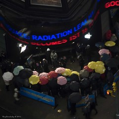Colorfully Patient Radiation Shields (raisinsawdust - (aka: tennphoto)) Tags: city nyc people newyork square nikon waiting timessquare umbrellas frommywindow goodmorningamerica 2011 intherain d90 nikond90
