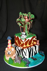 "Safari cake with tree and smash lion • <a style=""font-size:0.8em;"" href=""http://www.flickr.com/photos/60584691@N02/5585707651/"" target=""_blank"">View on Flickr</a>"