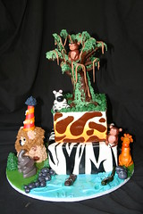 "Safari cake with tree and smash lion • <a style=""font-size:0.8em;"" href=""http://www.flickr.com/photos/60584691@N02/5585712935/"" target=""_blank"">View on Flickr</a>"