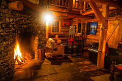 edited-01722 (www.AlastairHumphreys.com) Tags: red canada ontario explorecanada algonquin cabin hut evening lanterns lamp glowing firelight dinner meal food friends window fire