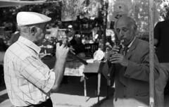 Playing Duduk (Dr. Harout) Tags: yerevan armenia vernissage outdoor streetphotography stphotographia monochrome bw blackandwhite film noiretblanc mordus nikon filmscan3600 microtek scan duduk music musician busker armenianduduk          chasseurdimage biancoenero