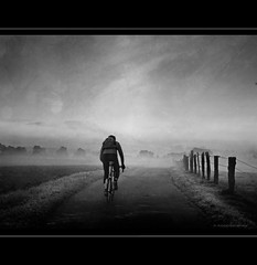 Cyclist in Morning Mist (h.koppdelaney) Tags: road morning light white mist black art nature bicycle fog digital training photoshop countryside cyclist ride symbol dream picture fairy valley photomontage awareness fitness lucid stillness tutorial conscious absoluteblackandwhite koppdelaney