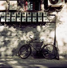 The Law of alley ( ken ) Tags: china street shadow 120 6x6 film bicycle wall alley kodak beijing greatwall          ektacolorpro160