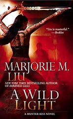July 27th 2010 by Penguin Group (USA) Inc.   A Wild Light (Hunter Kiss #3) by Marjorie M. Liu