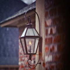 Faux Snow Day (Bruce Bordelon) Tags: house brick rain drops nikon gas flame lantern nikkor f28 shesabrickhouse 80200mm d700